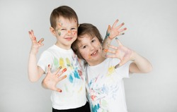 funny joint development for children - drawing with finger paints on clothes and body. hand paint, body painting in the company. children's body painting. creative intelligence. artistic development