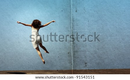 funny jump of young woman....