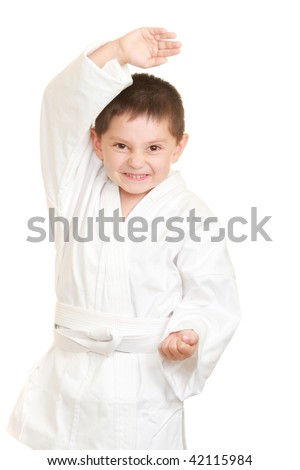 Funny karate kid in defense stance photo against white background ...