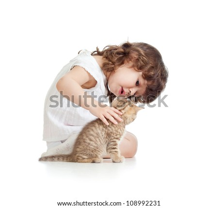 Funny kid girl playing with cat kitten