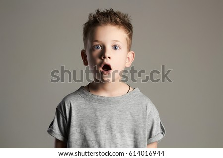 funny kid.handsome little boy.surprised 7 years old child #614016944