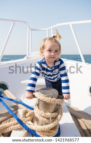 funny kid in striped marine shirt. small sailor on boat. summer vacation. childhood happiness. journey discovery. Transportation. happy small boy on yacht journey. Sea journey. journey concept. #1421968577
