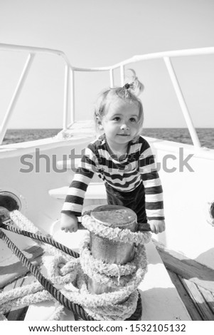 funny kid in striped marine shirt. small sailor on boat. summer vacation. childhood happiness. journey discovery. Transportation. happy small boy on yacht journey. Sea journey. journey concept. #1532105132