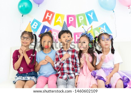 Funny kid with fake mustache and friends. Happy Asian children playing in birthday party. celebration party, Childhood, holidays, friendship concept #1460602109