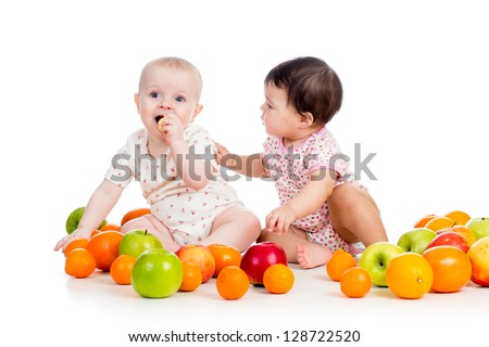 Funny kids babies eating healthy food fruits