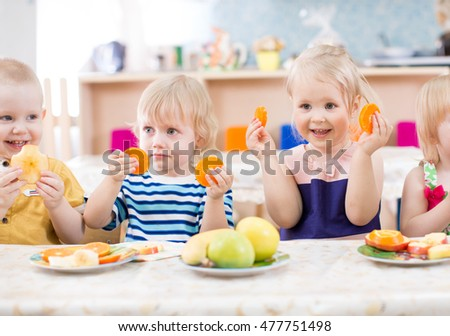 funny kids eating fruits in...