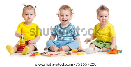 Stock Photo Funny kids group playing colorful toys isolated on white