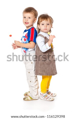 Funny kids in a studio. Isolated on a white background