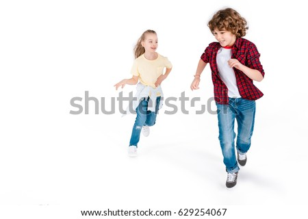 Funny kids playing in play catch-up isolated on white, gaming characters concept #629254067