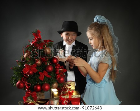 funny kids with christmas presents