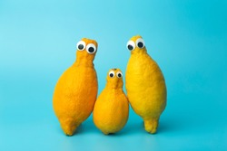 Funny lemons with eyes on a blue background. 