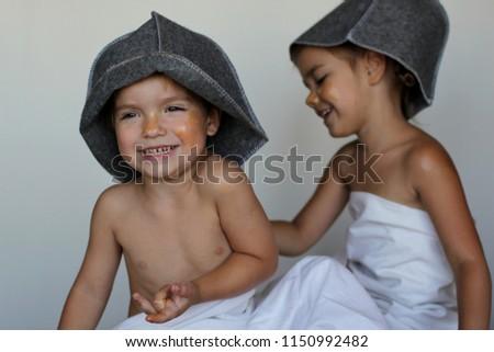 Free photos Happy family in hat relaxing at sauna. | Avopix.com