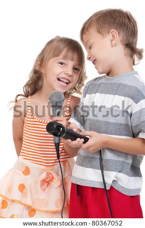 Funny little boy and girl singing with a microphone isolated on white background
