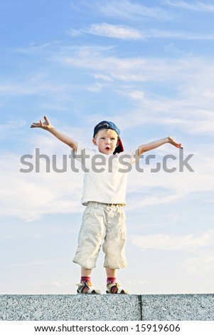 Funny little boy with hands up