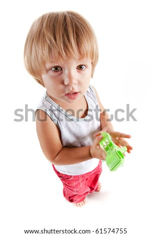 Funny little boy with toy, high angle view
