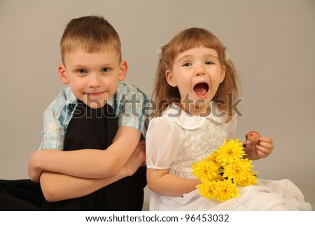 stock photo : funny little couple with flowers