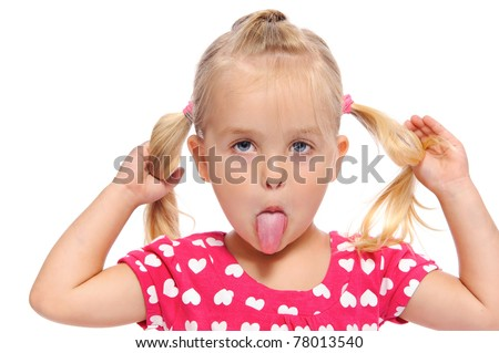 funny little girl makes a silly face while pulling on her pigtails