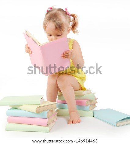 funny little girl reading books