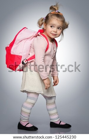 Funny little girl with backpack