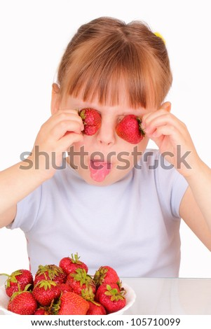 Funny little girl with tasty strawberries
