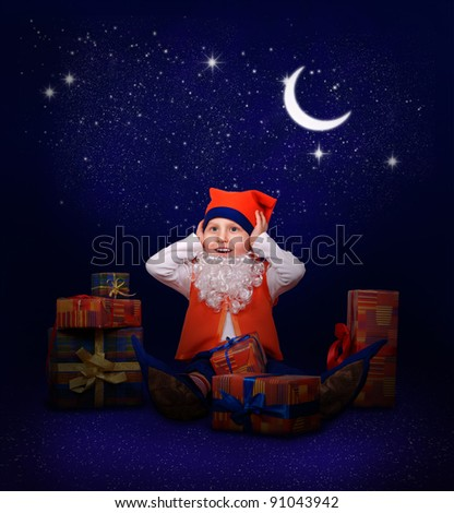 Funny little gnome with gift boxes at the last minutes to New Year midnight