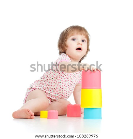 Funny little kid playing with cup toys, isolated over white