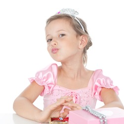 Funny little princess girl in silver crown and pink dress over white