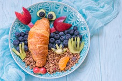 Funny Lobster Croissant with berries for kids breakfast