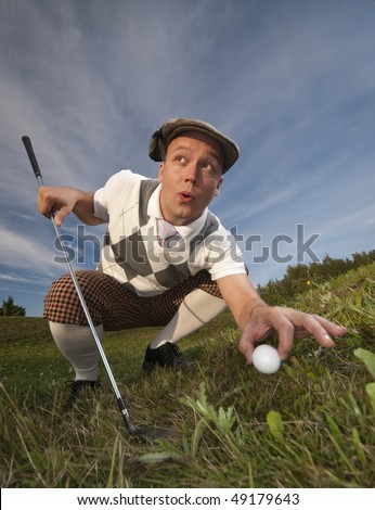 Funny looking golfer cheating and moving the ball when no one sees.