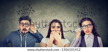 Funny looking man and woman having troubled communication trying to read someone's mind