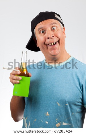 Funny looking middle age man with bad teeth holding a beer bottle and cigarette wearing a baseball cap.