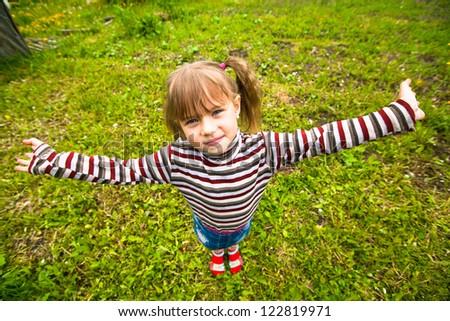 Funny lovely little girl in the park
