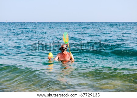 Funny Man Snorkeling With Fishing Net And Plastic Fish Stock