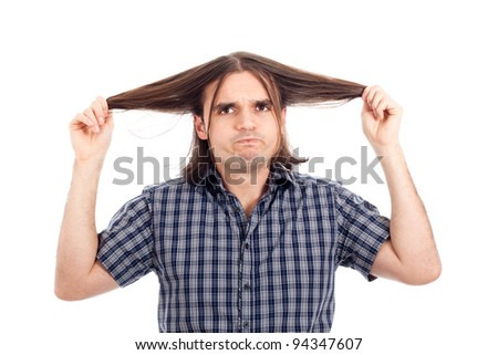 Funny man showing his long hair, isolated on white background.