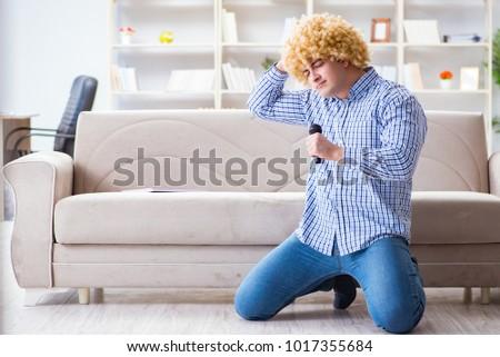 Funny man singing songs in karaoke at home #1017355684