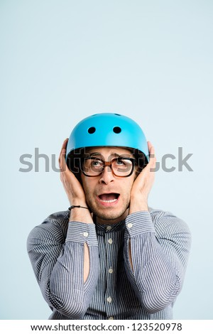 funny man wearing cycling helmet portrait real people high definition blue background