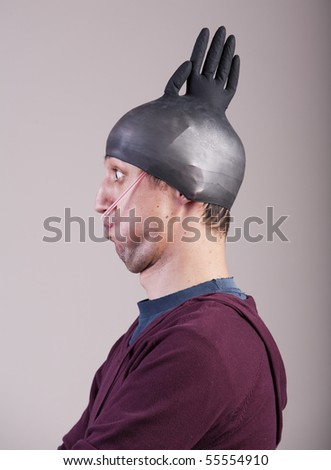 Funny Man With A Rubber Glove On His Head Stock Photo