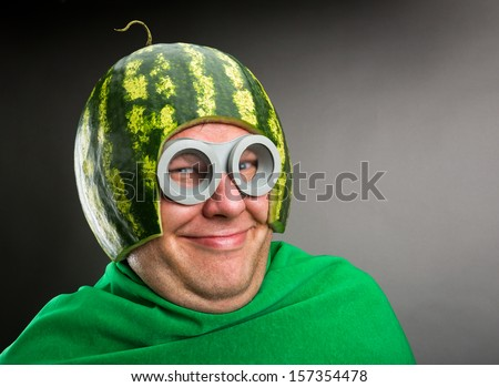 Funny man with watermelon helmet and googles looks like a parasitic caterpillar