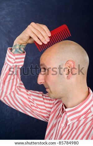 funny man without hair and comb