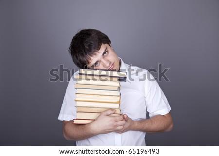 Funny men with books. Studio shot.
