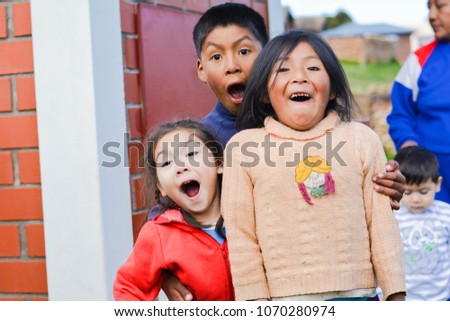 Funny native american children with opened mouth.