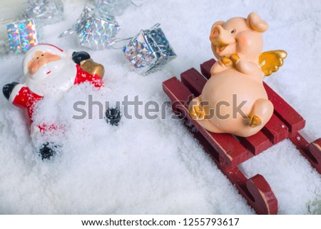 Funny naughty pig laughing at santa claus accident who fall from sleigh and lost gifts