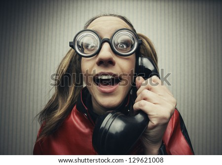 funny nerd humor woman talking retro vintage black telephone on vintage wallpaper