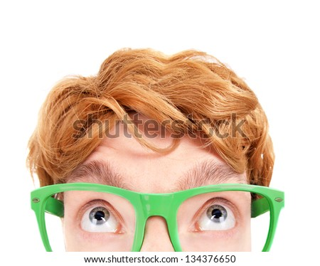 Funny nerdy guy looking up