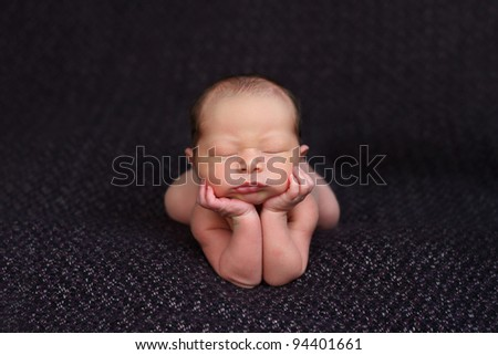 Funny newborn baby up on elbows. mix race: Caucasian and Asian