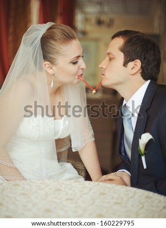 Funny newlywed couple in cafe. Happy newlywed couple at wedding.