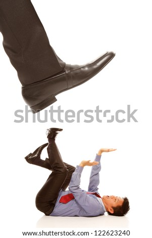 Funny office situation with a businessman or employee on the floor and about to be stepped on