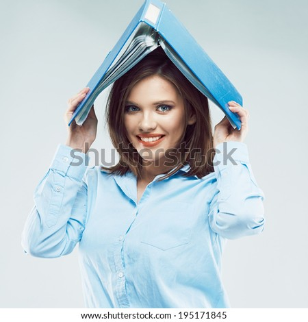 Funny office worker girl posing with paper folder on head.