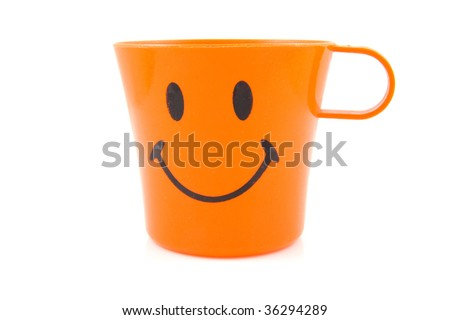 Funny orange drinking cup with smile isolated on white background