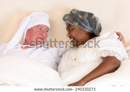 Funny photo of a vintage happy couple in bed